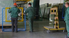 Four Workers and Man in Civilian Are Standing at the Metal Frame, Before the - stock footage