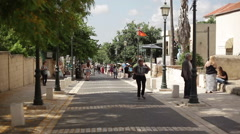 People walk in main street of Zikhron Ya'akov Stock Footage