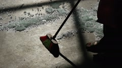 Worker, Silhouette, Feet Close Up, is Sweeping the Floor, Sweeping Crumbled Stock Footage