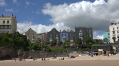 Holidaymakers on beach at Tenby holiday resort, Wales Stock Footage