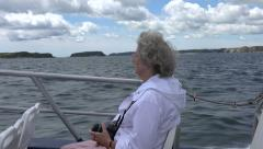 Senior woman on boat trip to Caldey Island, Tenby, Wales Stock Footage
