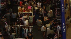 People in the shopping mall to buy clothes, in the night Stock Footage