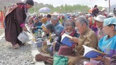 Devotees get tea at gathering with Sakya Trizin,Choglamsar,Ladakh,India Stock Footage