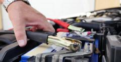 A person connects  the booster cables to the car battery Stock Footage
