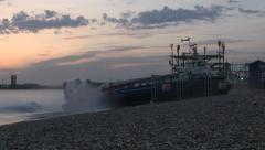 Isle of Wight Hovercraft Arriving at Southsea at Dusk Stock Footage