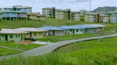 Colourful houses on hilly plain 02 Stock Footage