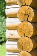 Stock Photo of Wall of a rural log house, detail of beams