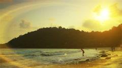 The sun falls on the evening beach. Stock Footage