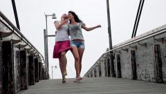 Happy women dancing on bridge in city Stock Footage