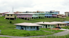 Colourful houses on hilly plain Stock Footage
