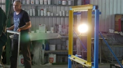 Two Workers and man in Civilian Are Establishing The Sheet of Glass in Metal - stock footage