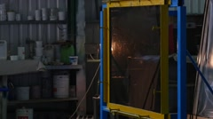 Stock Video Footage of Worker in Uniform And Protective Screen is Beating the Smooth Sheet of Glass