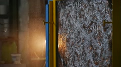 Beaten Glass Sheet, Beaten by Stick, Sheet of Glass is in Metal Frame, Stand, Stock Footage