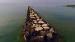Moving Over Calm Morning Harbor, Rocky Break Wall - stock footage
