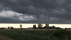 Dark storm clouds ahead of tornado warned thunderstorm in Ontario Stock Footage