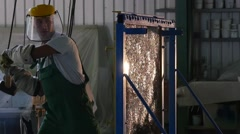 Stock Video Footage of Worker in Uniform and Protective Screen is Beating the Glass Sheet by Hummer,