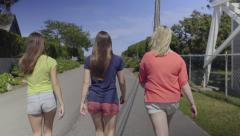 Best Friends Walk Down Street In New England (Slow Motion) Stock Footage