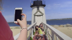 Girls Pose In Front Of New England Lighthouse For Photos (Slow Motion) Stock Footage