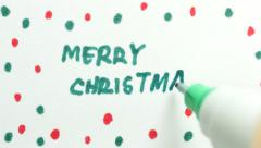 4K Merry Christmas Writing on Paper - stock footage