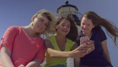 Teens Pose For Selfies With Lighthouse In Background (Slow Motion) Stock Footage