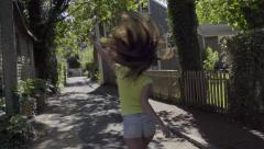Teen Girl Dances Down The Middle Of A Neighborhood Road (Slow Motion) Stock Footage