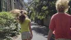 Carefree Teens Skip, Run, Dance Down Street In Quaint New England Neighborhood Stock Footage