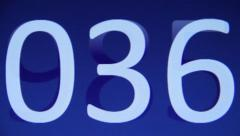 Blue digital clock counting Stock Footage