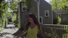 Funny Teen Girl  Runs Ahead And Acts Silly, Her Friend Catches Up (Slow Motion) Stock Footage