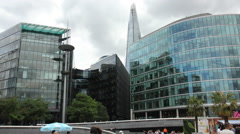 Modern buildings near London bridge Stock Footage