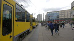 Train leaving the station and people crossing the railway, Berlin Stock Footage