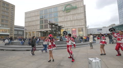 Young people dancing in front of Galeria Kaufhof, Berlin Stock Footage