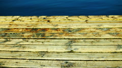 Wooden Pier And Indigo Water, Tilt. Holiday Landscape. - stock footage