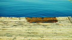 Wet Wooden Pier And Indigo Water, Tilt. Holiday Landscape. - stock footage