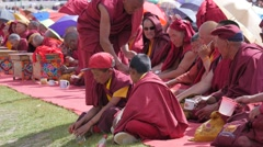 Young monks get tea served at gathering,Choglamsar,Ladakh,India Stock Footage