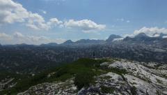 Beautiful Nature Fly around man on mounatintop 4K ULTRA HD Stock Footage