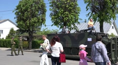 People with children pose in military army vehicle light tank. 4K Stock Footage