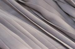 Closeup of gray fabric textile material as texture or background - stock photo