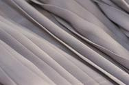 Stock Photo of Closeup of gray fabric textile material as texture or background