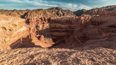 4K TimeLapse. Shadow play in Charyn grand canyon at sunset Stock Footage