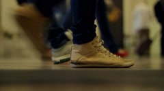 Tube station. People legs movement in rush hour. - stock footage