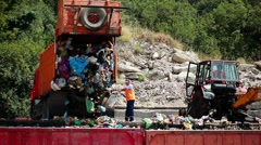 Machine unloads garbage in a landfill. City dump. Stock Footage