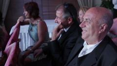 Spaniards sit at the wedding ceremony. Positive laughing men. Stock Footage