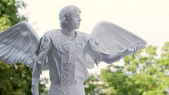 Living statue is moving before the public. Sad angel. - stock footage