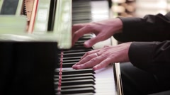 Pianist plays the piano. Pianist's fingers run over the keys. Stock Footage