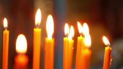 Burning candles. A lot of candles are burning on a candlestick. Stock Footage