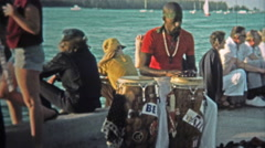 1973: Local Caribbean talented musicians playing conga drums on tourist travel Stock Footage
