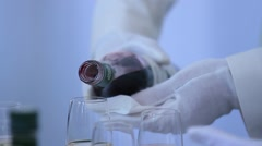 Wine tasting. Waiter pours wine into the glasses. Stock Footage