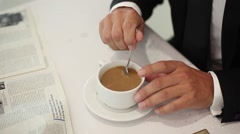 Man drinking coffee. Man reading the newspaper with a cup of coffee. Stock Footage