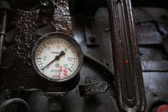 Locomotive's manometer in dark - stock photo