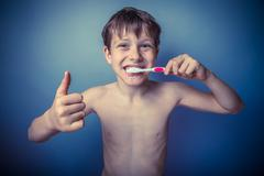Teenage boy about ten years old European appearance brown naked - stock photo